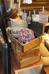 Vintage luggage displaying custom pillow and sample event cards.
