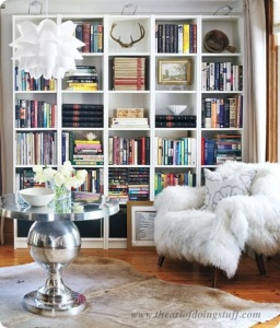 Well Styled Library: Similar sized  books and collections of books are grouped. Notice the well placed art on the wall to fill a shelf rather than books.